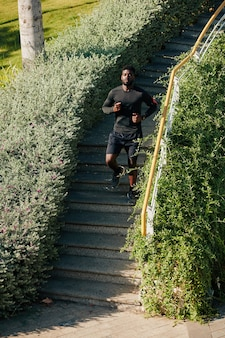 Sportsman running down the stairs