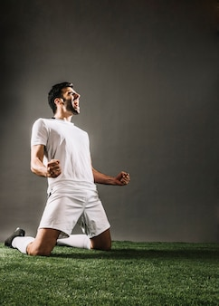 Sportsman shouting while rejoicing over victory