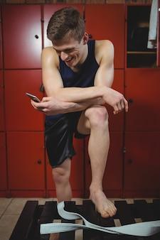 Sportsman using mobile phone