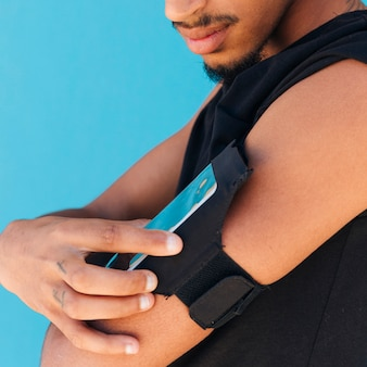 Sportsman using phone in case on arm