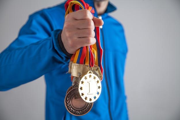 메달과 스포츠맨. 스포츠, 우승자, 성공