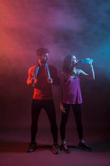 Sportspeople in dark studio after training