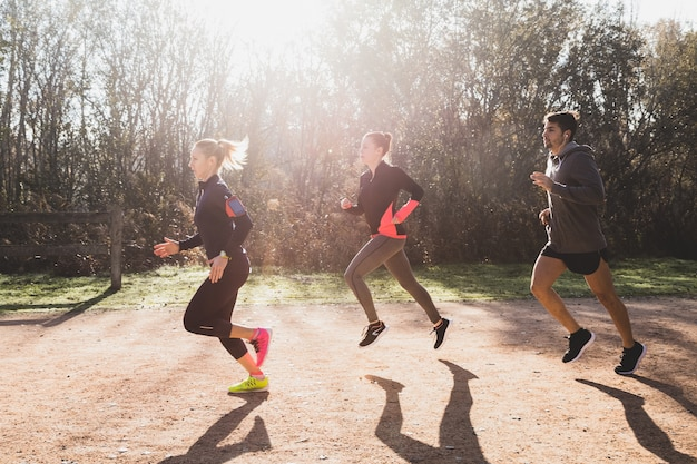 Sportspeople running in a row