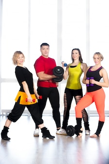 Sportspeople in shape with dumbbells