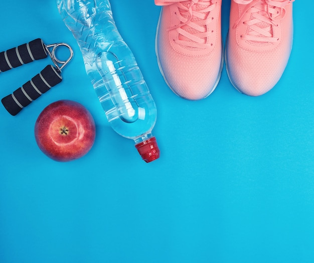 Sportswear and pink sneakers with laces