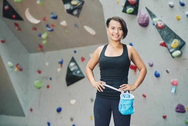 Sportswoman in climbing club