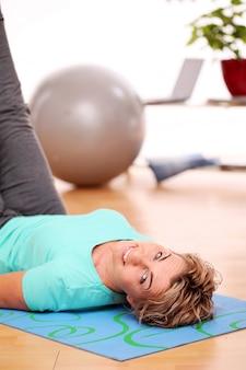 Sportswoman doing exercises