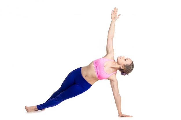 Sportswoman in shape stretching her body