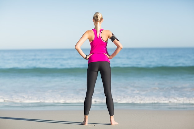 Sportswoman standing on beach
