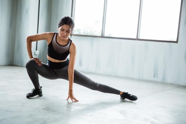 Sportswoman starting exercise
