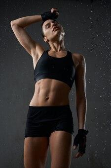 Sportswoman wiping sweat off forehead