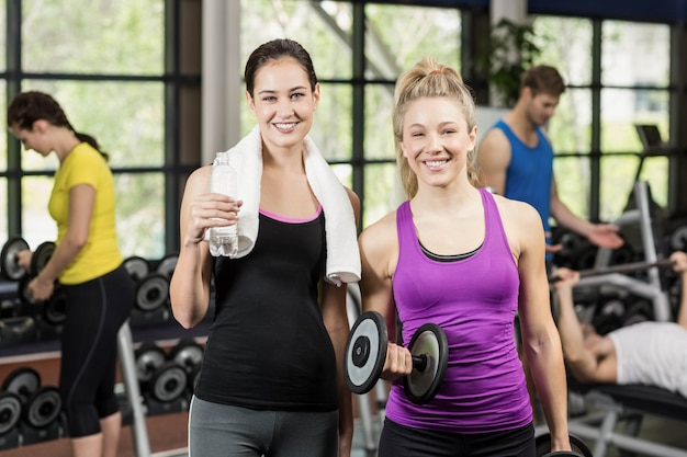Sportswomen talking together at gym