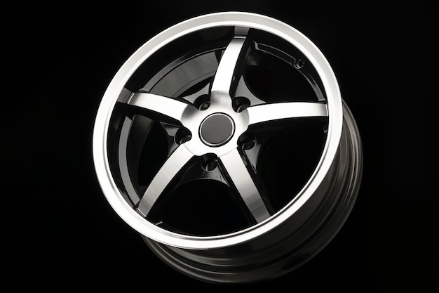 Sporty alloy wheel, black with polishing. side view close-up.