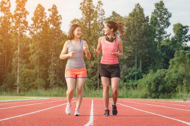 Sporty asian woman runner in fashionable sportswear.