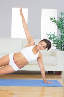 Sporty calm woman practicing yoga pose