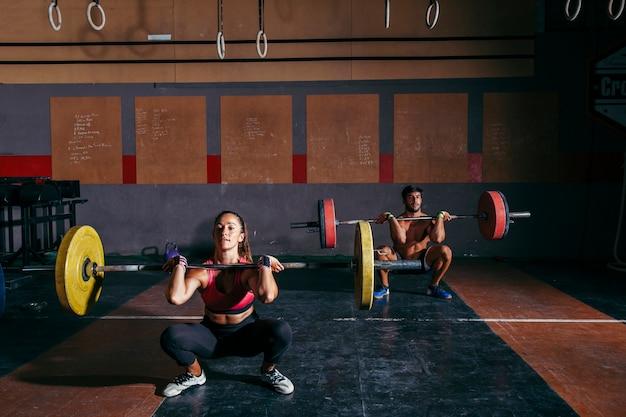 Sporty couple doing bodybuilding