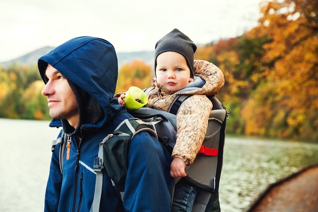 Sporty father and his cute little son walking on bled lake slovenia europe