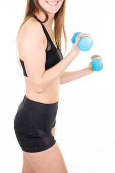 Sporty fit woman do workout with dumbbells isolated on white