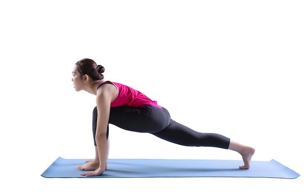 Sporty fit women practices yoga anjaneyasana exercise bend yoga pose on rubber mat