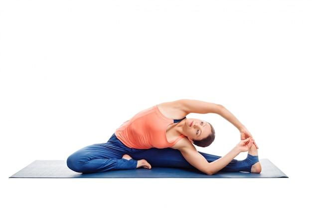 Sporty fit yogini woman practices yoga asana parivrtta janu sirs