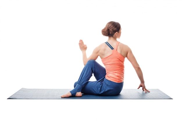 Sporty fit yogini woman practices yoga asana