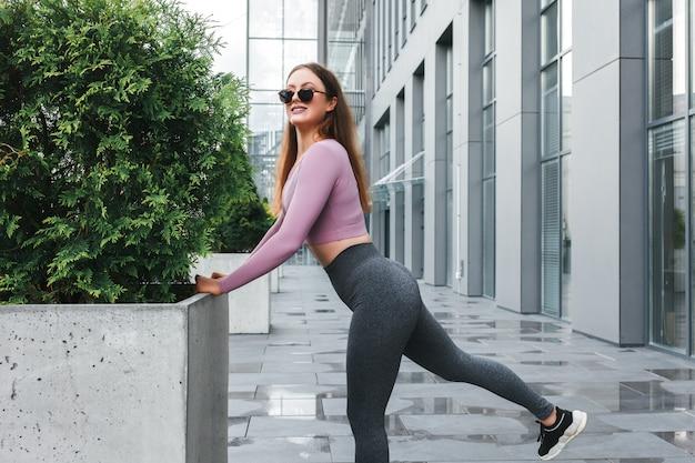 Sporty girl doing morning exercises