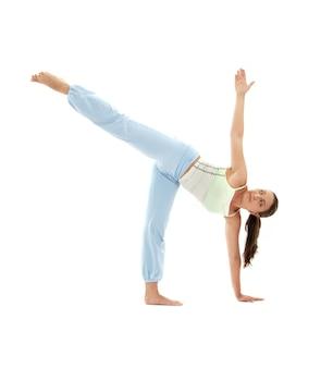 Sporty girl practicing ardha chandrasana half moon pose
