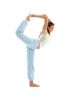 Sporty girl practicing natarajasana lord of the dance pose