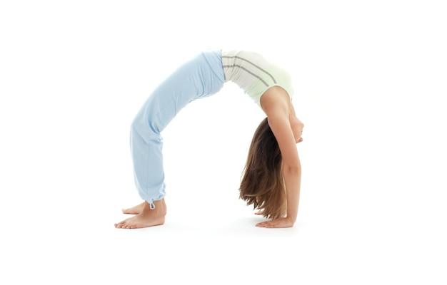 Sporty girl practicing urdhva dhanurasana upward bow pose Premium Photo