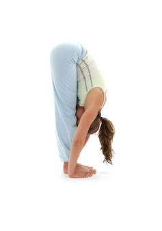 Sporty girl practicing uttanasana standing forward bend