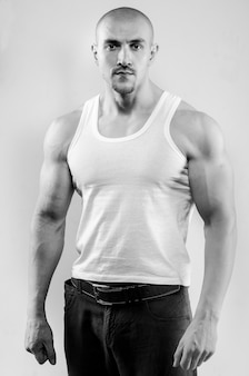 Sporty guy posing in the studio on the. sports, beauty, black and white photography.