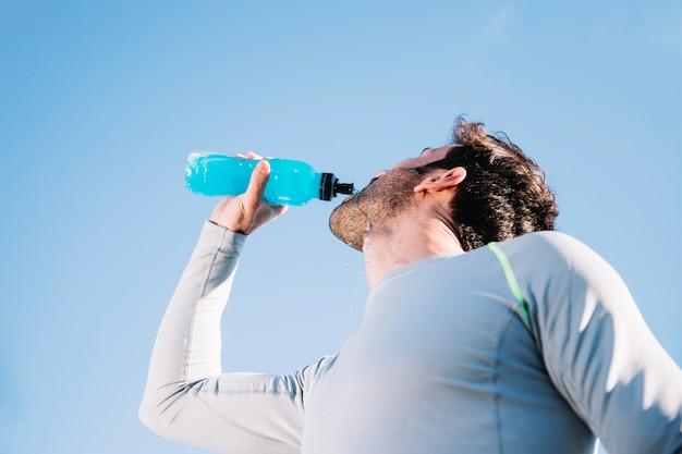 Sporty man drinking water