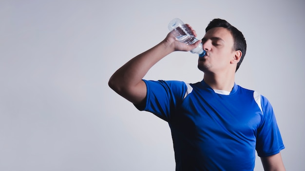 Sporty man drinking