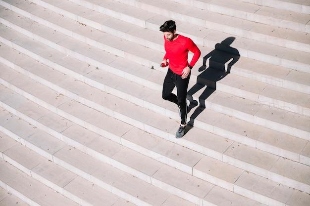 Sporty man running downstairs