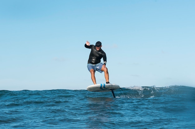 Sporty man surfing in hawaii