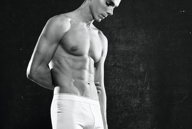 Sporty man in white panties pumped up body workout motivation