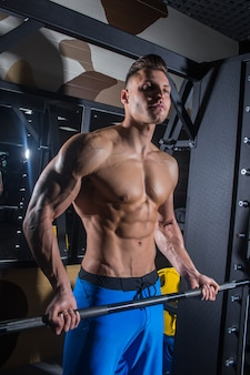 Sporty man with big muscles fitness abdominal press