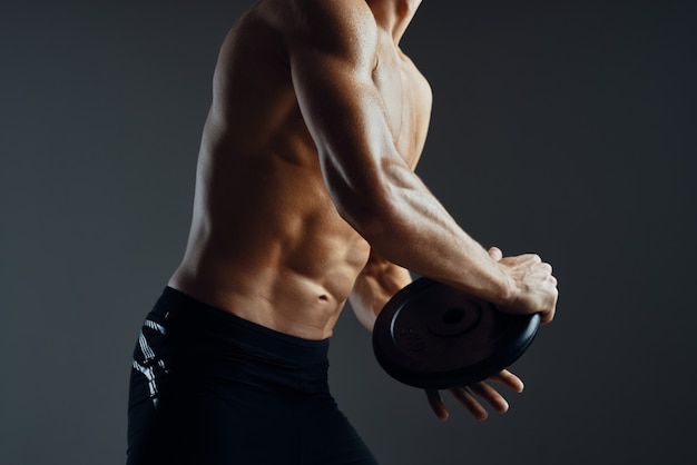 Sporty man with pumped body exercise fitness isolated background