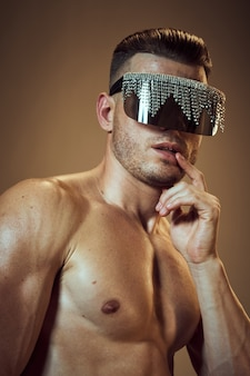 Sporty man with pumped body fashion glasses model