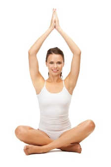 Sporty woman in cotton undrewear practicing yoga lotus pose