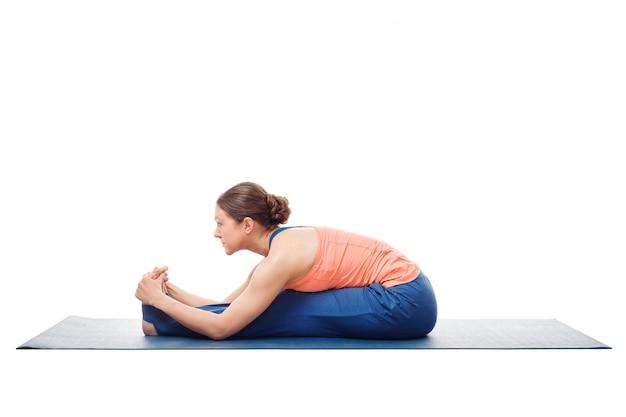 Sporty woman doing ashtanga vinyasa yoga asana
