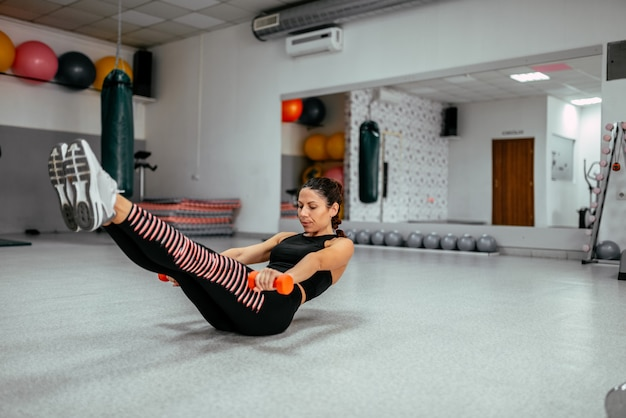 Sporty woman doing power fitness exercise at the gym