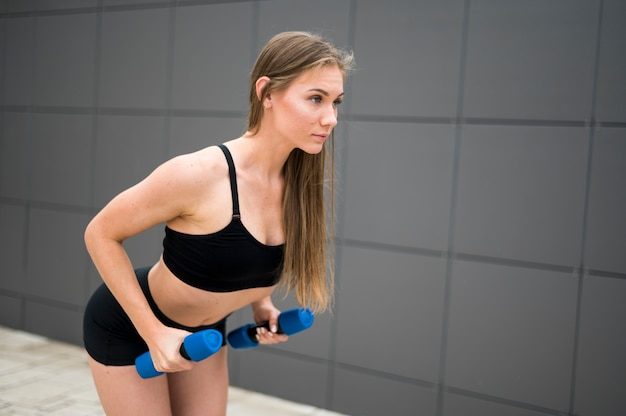 Sporty woman doing sport exercises