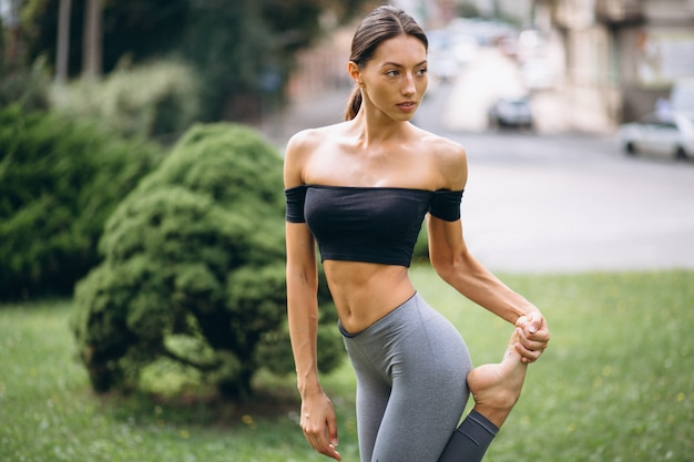 Sporty woman exercising in park