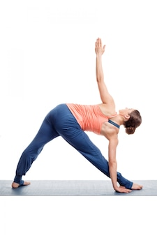 Sporty woman practices ashtanga vinyasa yoga asana