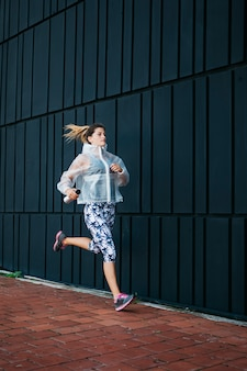 Sporty woman running in urban environment