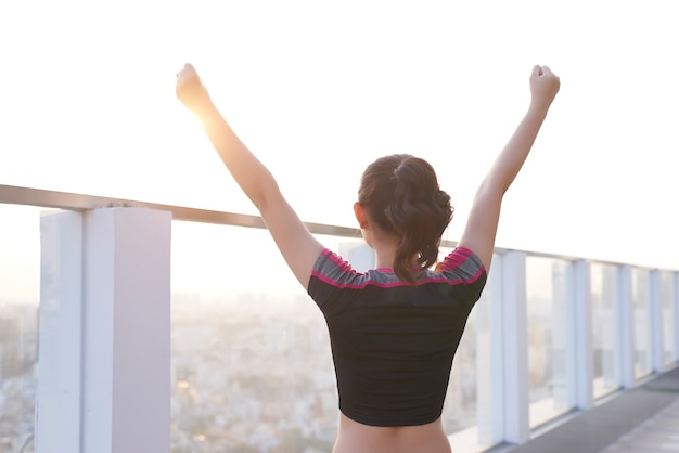 Sporty woman stretching her arms in the morning.