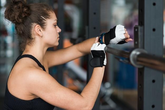 Sporty woman using smartwatch