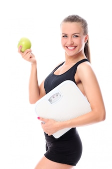 Sporty woman with apple