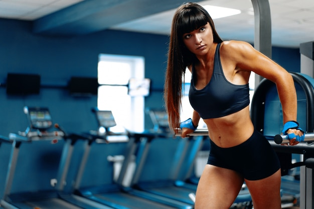 Sporty woman working out in a gym